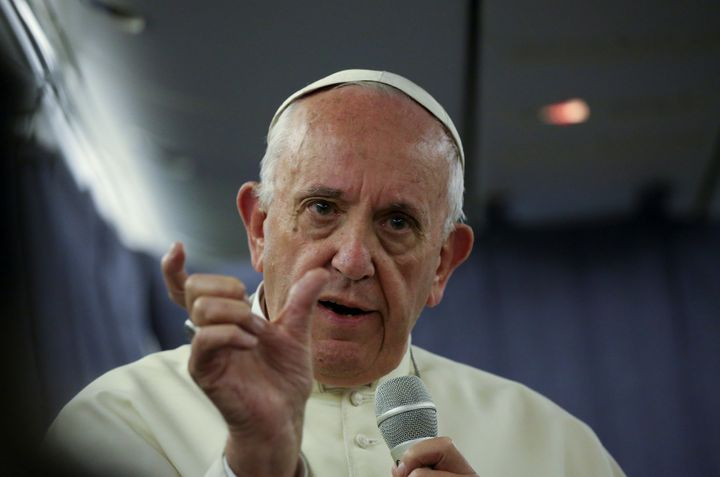 Pope Francis gestures during a Jan. 22 news conference during his flight back from a trip to Chile and Peru.