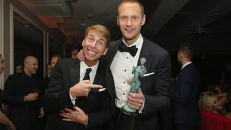 WEST HOLLYWOOD, CA - JANUARY 21:  Actors Jack McBrayer and Alexander Skarsgard attend Netflix Hosts The SAG After Party At The Sunset Tower Hotel on January 21, 2018 in West Hollywood, California.  (Photo by Rachel Murray/Getty Images for Netflix)