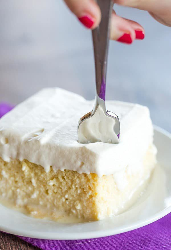 "<strong>Get the <a href=""https://www.browneyedbaker.com/tres-leches-cake-recipe/"" target=""_blank"">Tres Leches Cake</a> recipe"