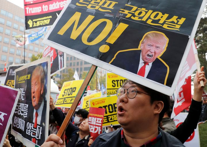 Protesters gather near the South Korean National Assembly in Seoul, where Trump spoke in November.