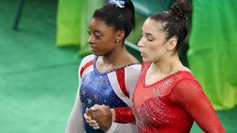 2016 Rio Olympics - Artistic Gymnastics - Final - Women's Individual All-Around Final - Rio Olympic Arena - Rio de Janeiro, Brazil - 11/08/2016. Simone Biles (USA) of USA (L) and Alexandra Raisman (USA) of USA (Aly Raisman) hold hands during the women's individual all-around final. REUTERS/Damir Sagolj FOR EDITORIAL USE ONLY. NOT FOR SALE FOR MARKETING OR ADVERTISING CAMPAIGNS