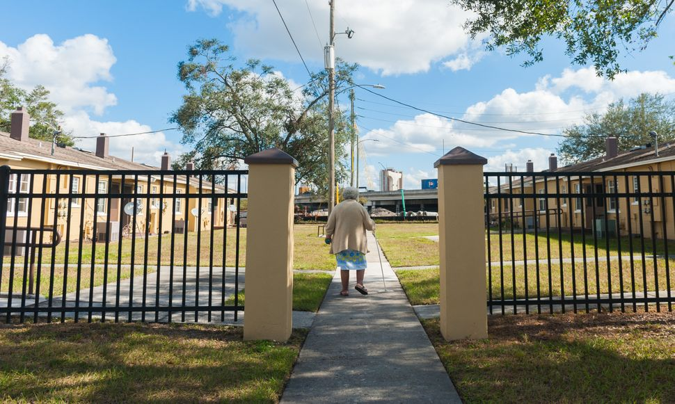 Marita Wilson, who is often troubled by asthma, walks to her home in Griffin