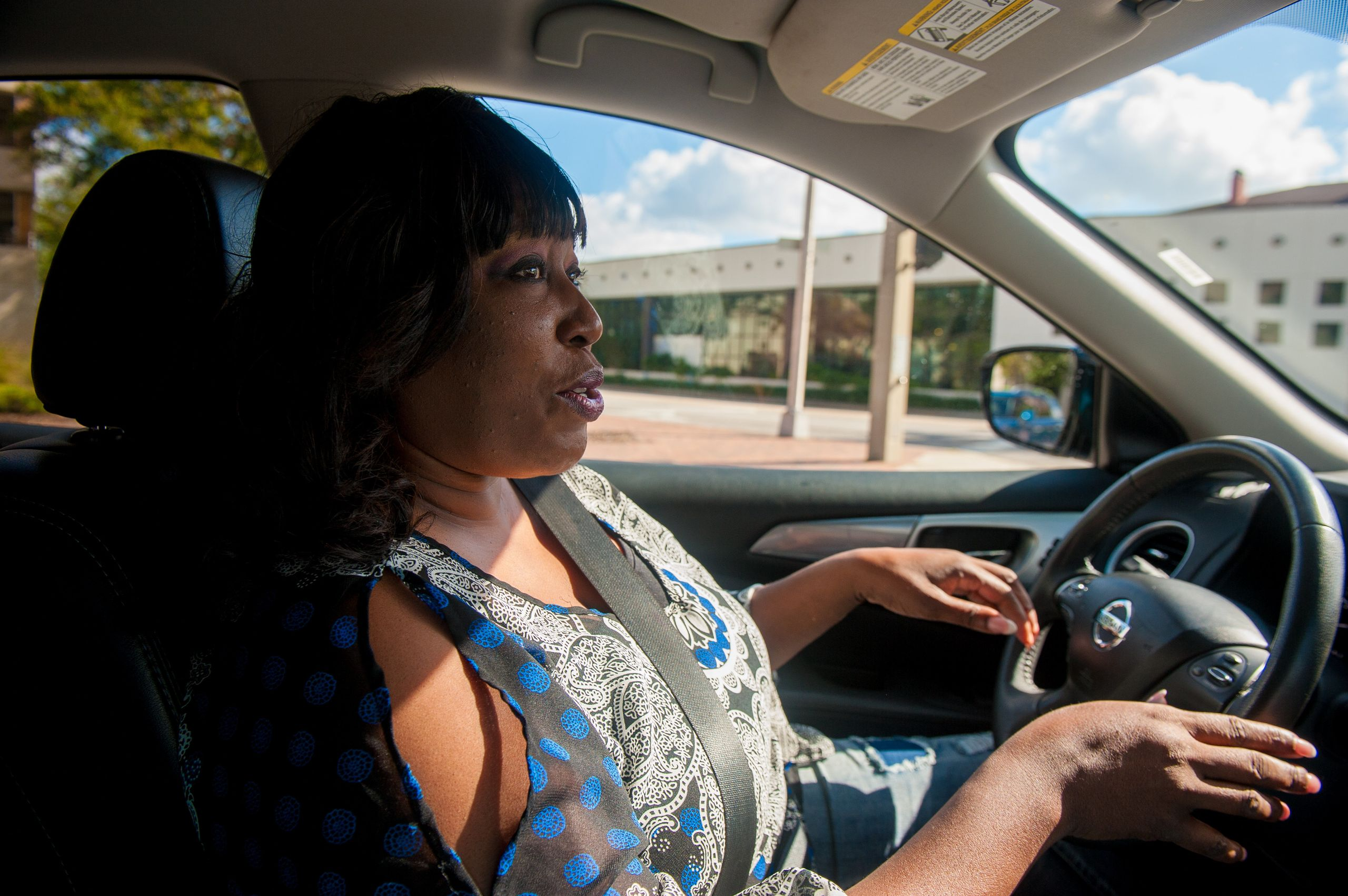 Lawanna Gelzer, an environmental justice activist, tours the Parramore neighborhood in her car.