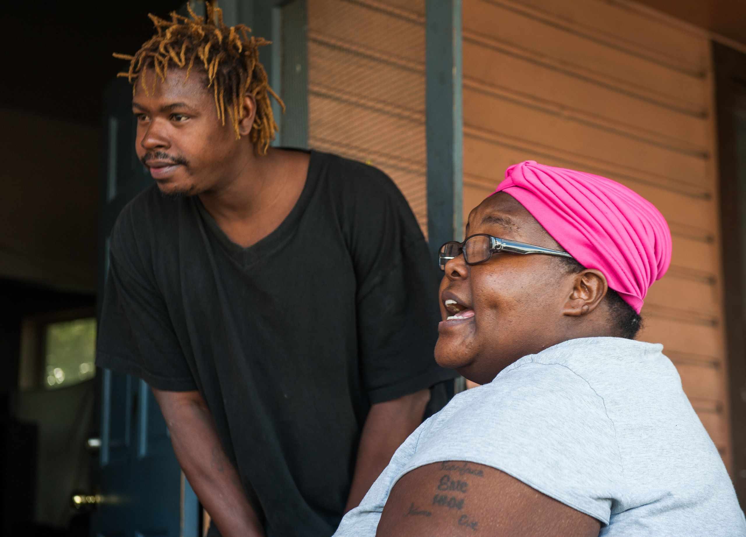 Allen and Latoya Lee talk on the porch of their Parramore home in November 2017.