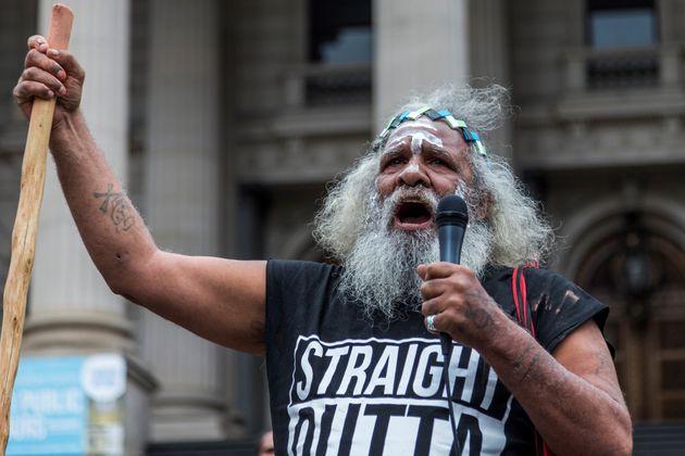An elder protester speaks during a demonstration on Australia Day on Jan. 26,