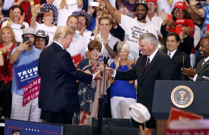 Franklin Graham is greeted by President Donald Trump during a rally on Aug. 22, 2017, in Phoenix.