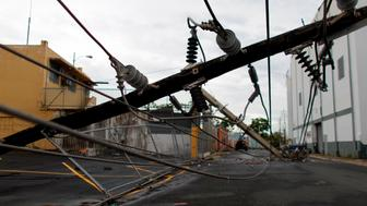 Power line poles downed by the passing of Hurricane Maria lie on a street in San Juan, Puerto Rico on November 7, 2017.  The Center for Puerto Rican Studies at Hunter College in New York estimated in a report released last month that about 114,000 to 213,000 Puerto Rican residents will leave the island annually 'as a result of Hurricane Maria.' / AFP PHOTO / Ricardo ARDUENGO        (Photo credit should read RICARDO ARDUENGO/AFP/Getty Images)