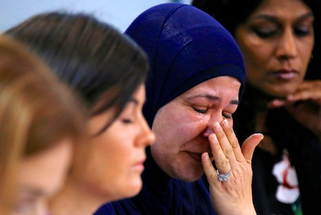 A woman whose relatives are currently being held on the island of Nauru cries at a news conference in...