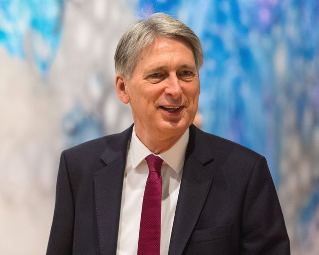 Philip Hammond has given Boris Johnson a rebuke for raising the prospect of more money for the