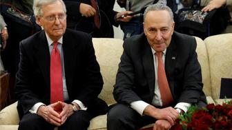 Senate Majority Leader Mitch McConnell and Senate Minority Leader Chuck Schumer take part in a meeting with U.S. President Donald Trump and other Congressional leaders in the Oval Office of the White House in Washington, U.S., December 7, 2017.  REUTERS/Kevin Lamarque