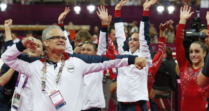 Geddert celebrates with USA Gymnastics team after the U.S. won gold for the artistic gymnastics event during the London games