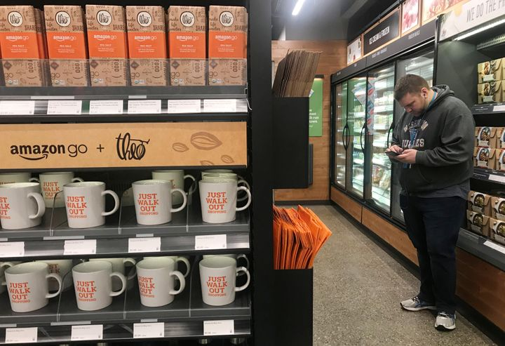 A shopper in the line-free Amazon Go store in Seattle.