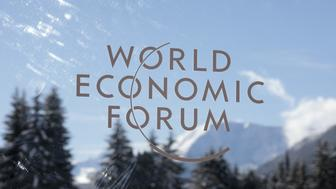 The World Economic Forum (WEF) logo sits on a pane of glass during on the opening day of the annual forum in Davos, Switzerland, on Tuesday, Jan. 23, 2018. World leaders, influential executives, bankers and policy makers attend the 48th annual meeting of the World Economic Forum in Davos from Jan. 23 - 26. Photographer: Jason Alden/Bloomberg via Getty Images