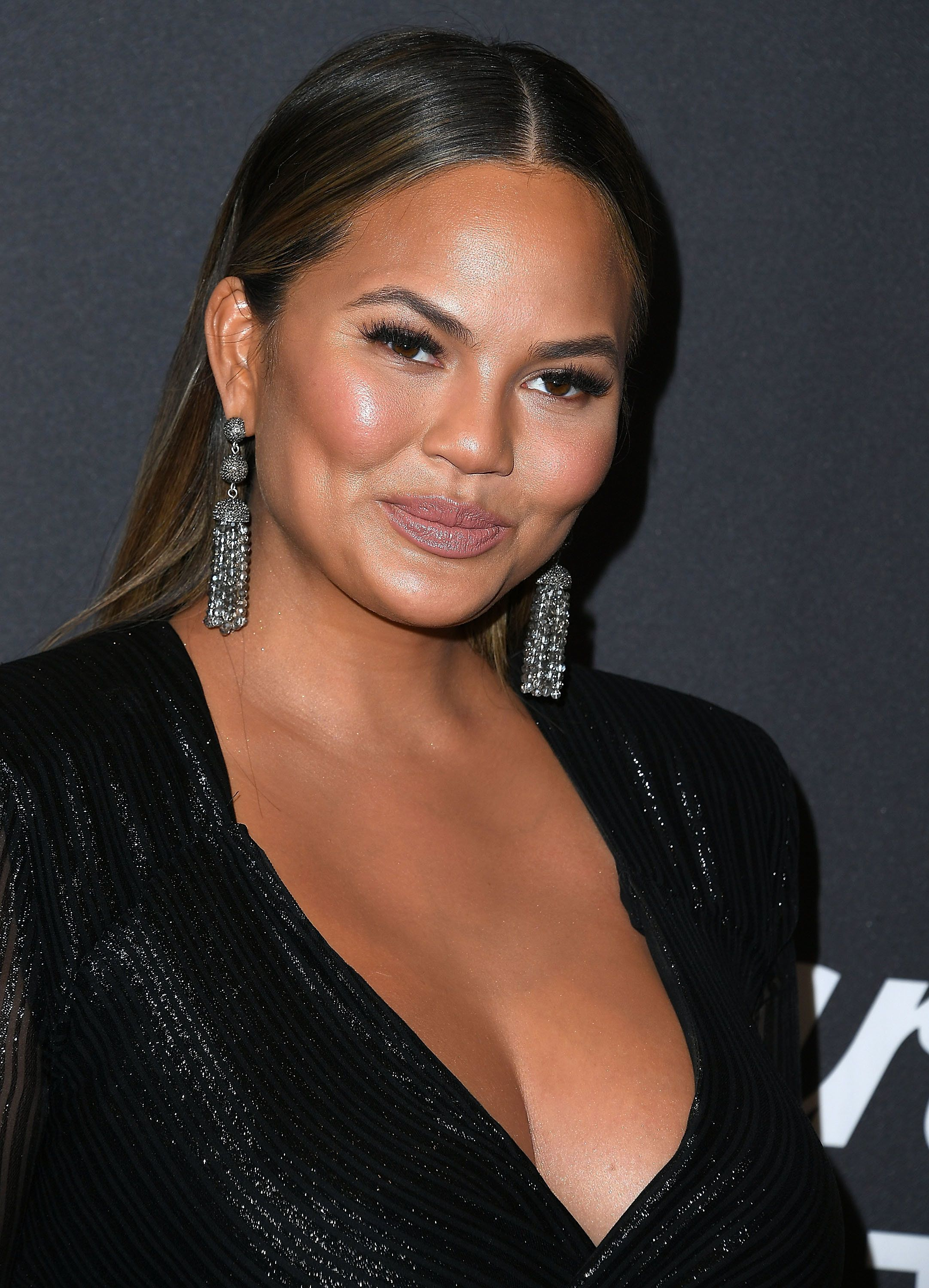 Chrissy Teigen Inspires Women To Celebrate Their Grey Hair With