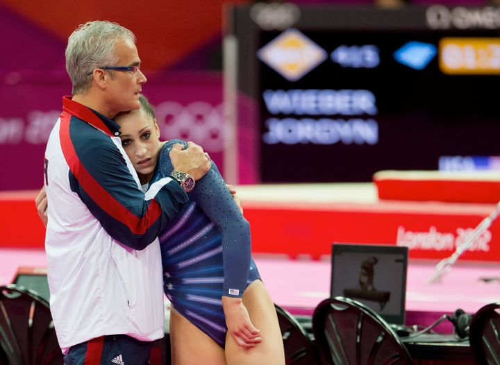 Geddert with Wieber at the 2012 Summer Olympic Games in London on Aug. 7, 2012.