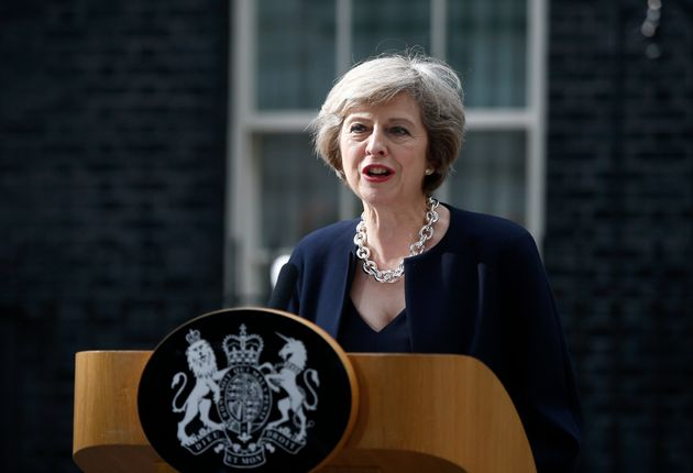 Theresa May speaking to the media on the steps of Downing