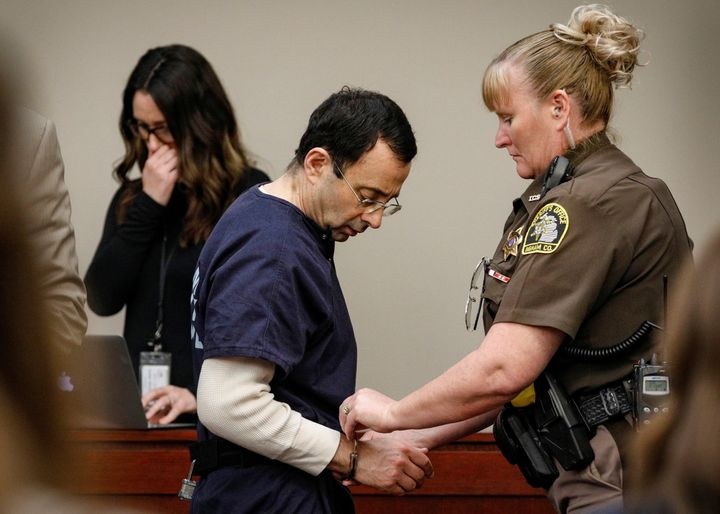 Nassar is handcuffed in the courtroom at the end of a day of testimony during his sentencing hearing.
