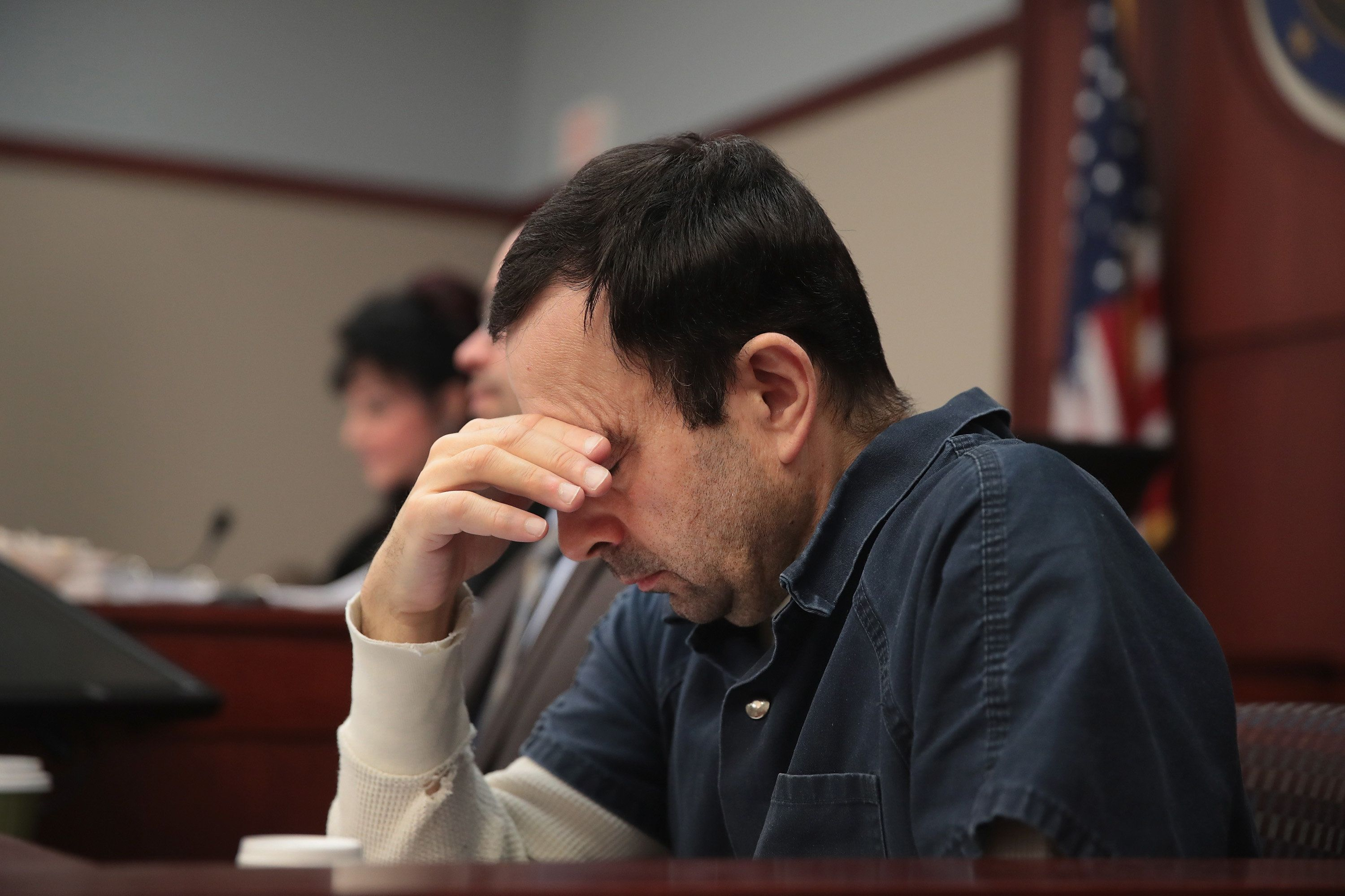 LANSING, MI - JANUARY 17:  Larry Nassar listens to  victim impact statements during his sentencing hearing after being accused of molesting more than 100 girls while he was a physician for USA Gymnastics and Michigan State University where he had his sports-medicine practice on January 17, 2018 in Lansing, Michigan. Nassar has pleaded guilty in Ingham County, Michigan, to sexually assaulting seven girls, but the judge is allowing all his accusers to speak. Nassar is currently serving a 60-year sentence in federal prison for possession of child pornography.  (Photo by Scott Olson/Getty Images)