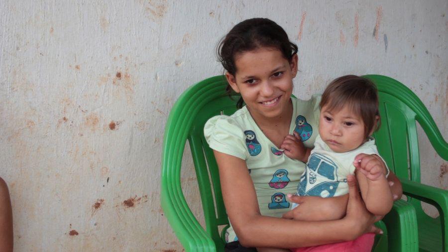 De Barros' son Miguel was born with microcephaly. Here, the baby is held by de Barros' daughter Juliana, age 12.