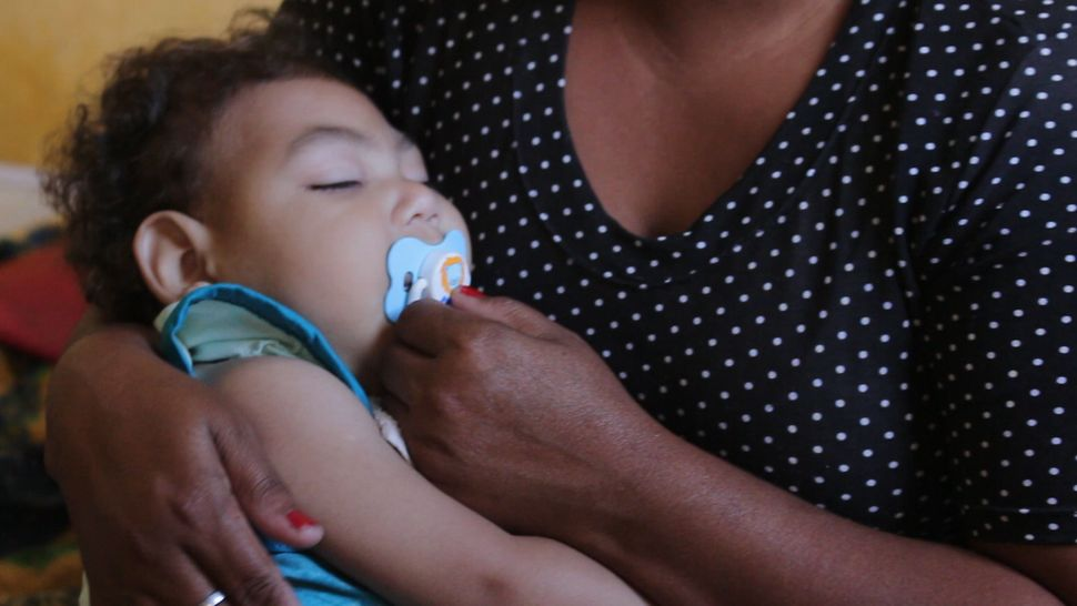 Silva holds Gabriel, 2, who was born with congenital Zika syndrome.