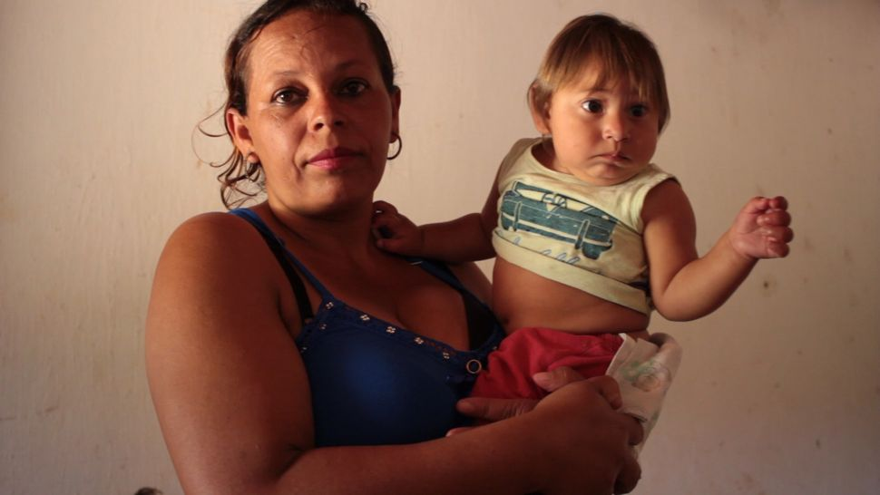 Rosângela Ferreira de Barros holds her son Miguel, who was born with congenital Zika syndrome.