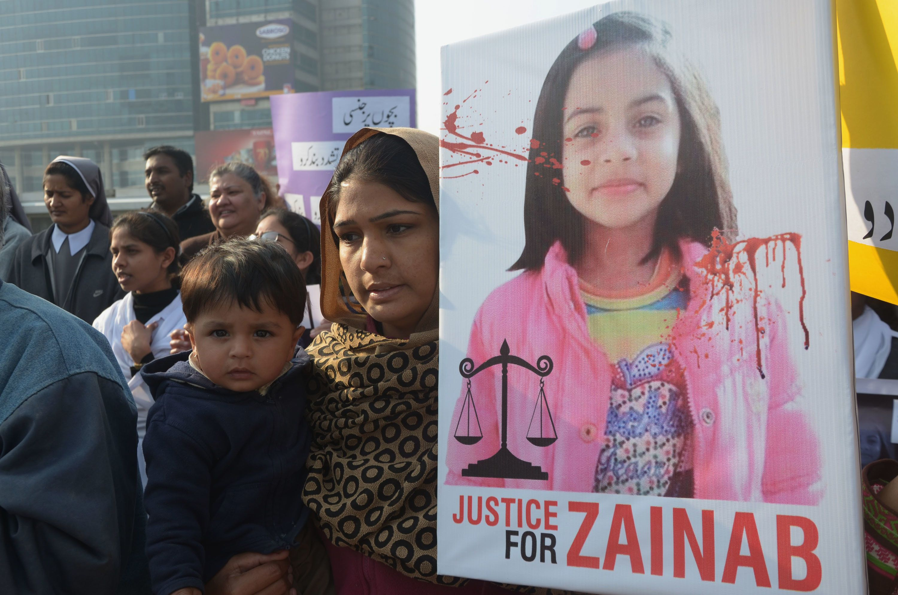 LAHORE, PUNJAB, PAKISTAN - 2018/01/14: Pakistani Activists of Cecil Chaudhry and Iris Foundation (CCIF) holding placards chant slogans to protest the rape and murder of seven year old Zainab Ansari in Kasur District at Liberty Chowk in Lahore on January 14, 2018. Hundreds of protesters enraged over the murder of a young girl threw stones at government buildings in a Pakistani city near the Indian border for a second day January 11, amid growing outrage over the killing. (Photo by Rana Sajid Hussain/Pacific Press/LightRocket via Getty Images)