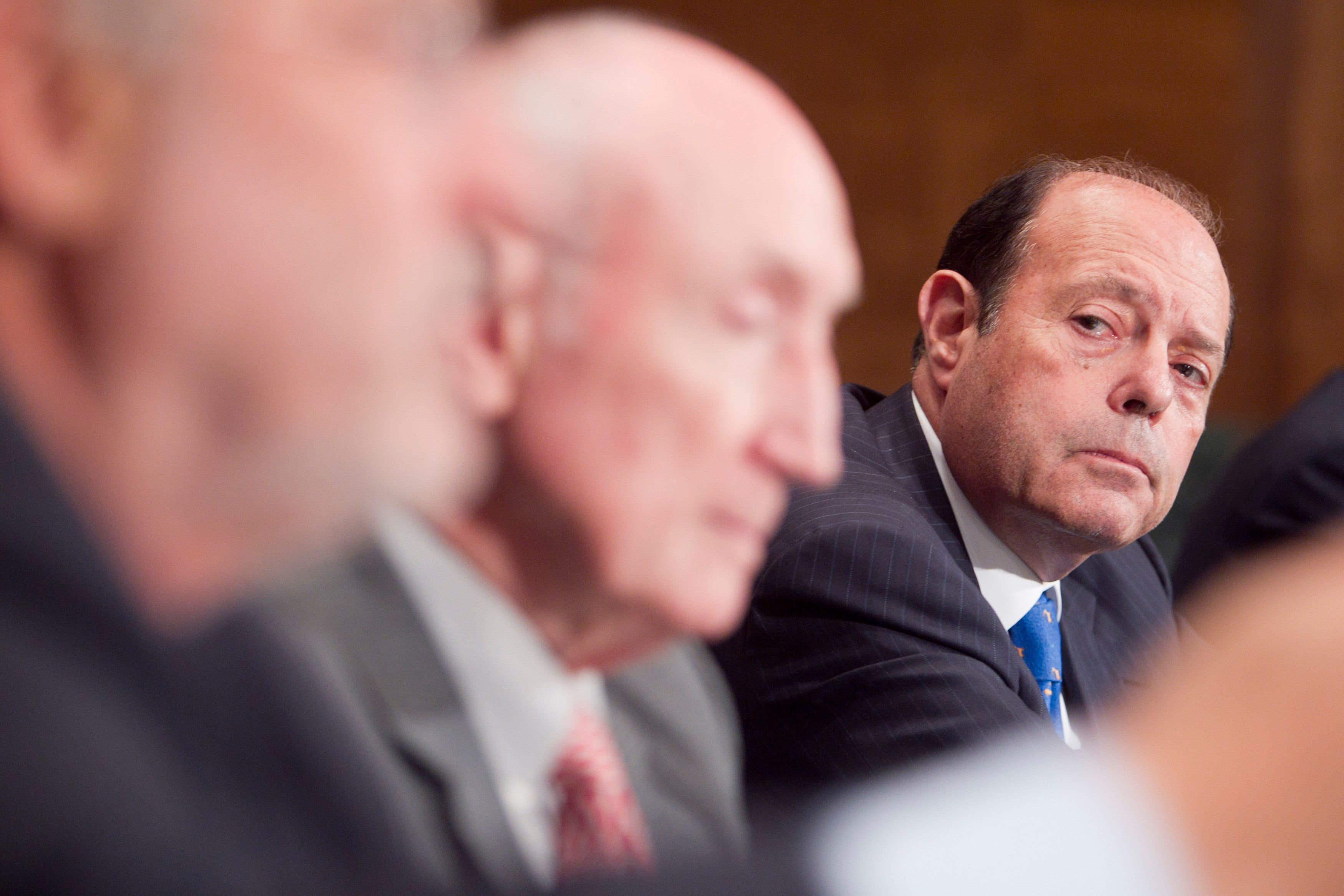 Eugene Ludwig, chief executive officer of Promontory Financial Group LLC, right, and Edward Kane, professor of finance at Boston College, listen to Joseph Stiglitz, Nobel prize-winning economist and professor of economics at Columbia University, during a Senate Banking Subcommittee on Financial Institutions in Washington, D.C., U.S., on Wednesday, Aug. 3, 2011. The hearing today was entitled, 'Debt Financing in the Domestic Financial Sector.' Photographer: Andrew Harrer/Bloomberg via Getty Images