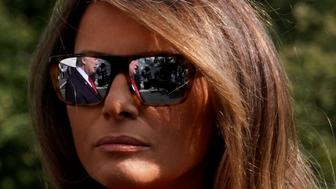 U.S. President Donald Trump is reflected in sunglasses of first lady Melania Trump as talks to the media about Hurricane Irma on the South Lawn the White House upon their return to Washington, U.S., from Camp David, September 10, 2017. REUTERS/Yuri Gripas