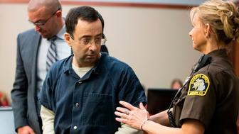 Former USA Gymnastics doctor Larry Nassar is about to be led away following his sentencing hearing in Lansing, Michigan, January 16, 2018. Victims of sexual abuse by Nassar delivered gut-wrenching emotional testimony at the court hearing which could see him sentenced to prison for life. Nassar has been accused of molesting more than 100 female athletes during the three decades he worked with USA Gymnastics and at Michigan State University. / AFP PHOTO / Geoff Robins        (Photo credit should read GEOFF ROBINS/AFP/Getty Images)