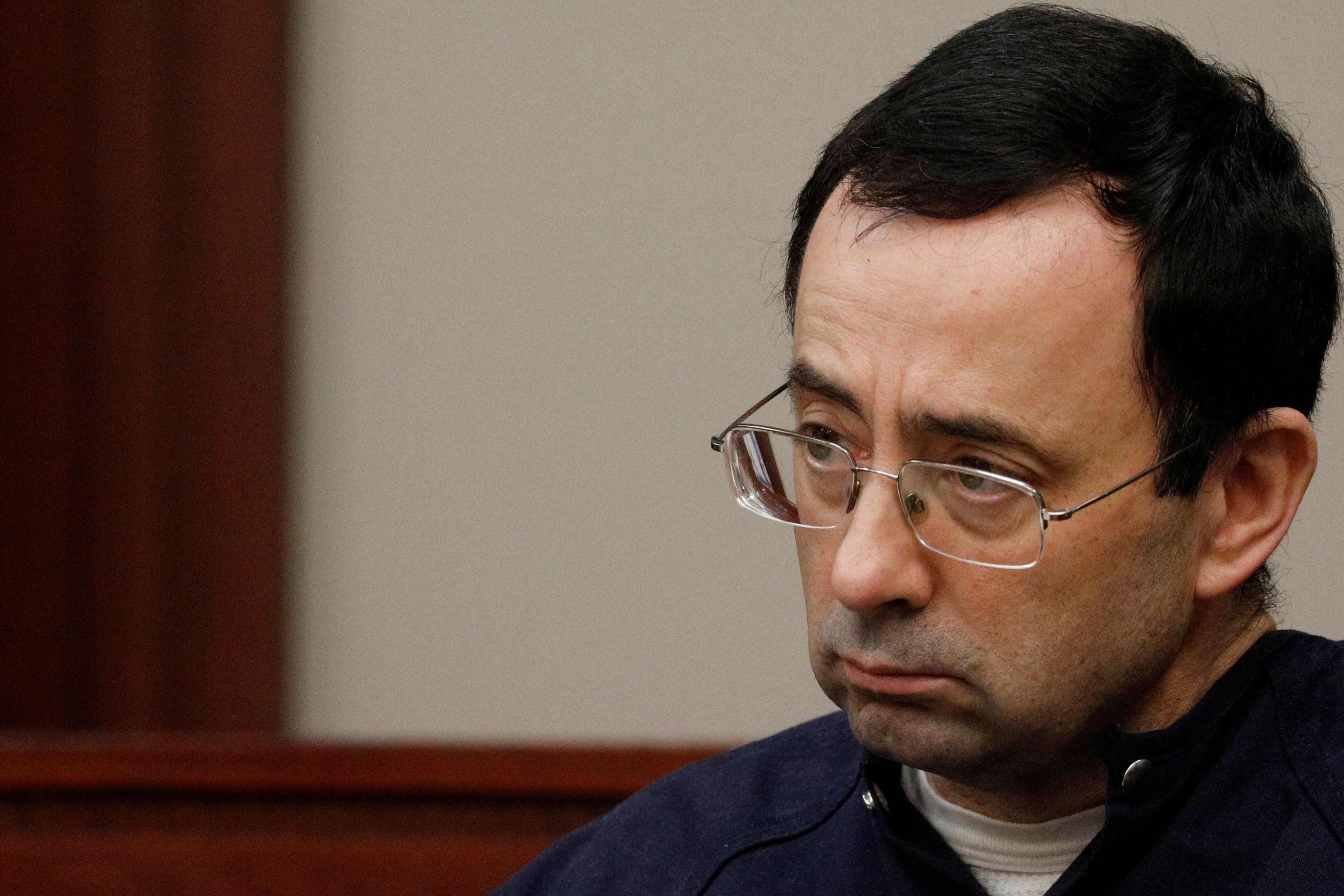 Larry Nassar, a former team USA Gymnastics doctor who pleaded guilty in November 2017 to sexual assault charges, sits in the courtroom during his sentencing hearing in Lansing, Michigan, U.S., January 22, 2018. REUTERS/Brendan McDermid