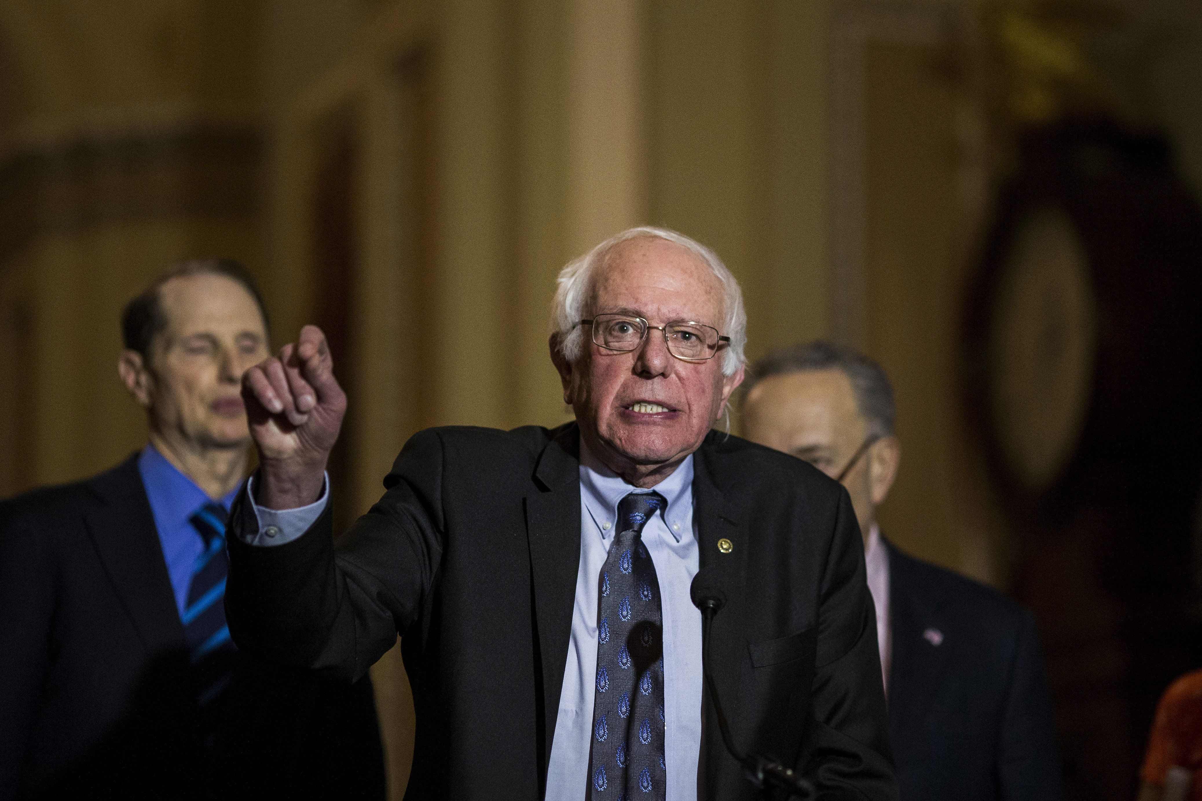 Senator Bernie Sanders, an Independent from Vermont, speaks during a news conference following a weekly policy luncheon on Capitol Hill in Washington, D.C., U.S., on Tuesday, Dec. 19, 2017. This week marks the last leg of Republicans' push to revamp the U.S. tax code, with both the House and Senate planning to vote by Wednesday on final legislation before sending it to President Donald Trump. Photographer: Zach Gibson/Bloomberg via Getty Images