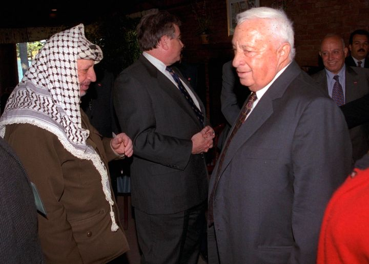 A story in The New York Times details former Israeli Prime Minister Ariel Sharon's (right) decades-long attempt to assassinate PLO leader Yasir Arafat (left).