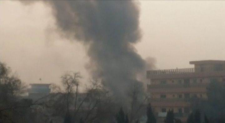 Smoke rises from a blast near the office of the Save the Children aid agency in Jalalabad, Afghanistan, on Wednesday.