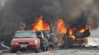 Vehicles are seen on fire after a blast in Jalalabad, Afghanistan January 24, 2018.REUTERS/Parwiz