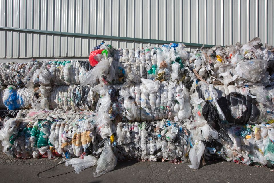 Compressed blocks of plastic waste, which would have been exported to China, pile up at Far West Recycling...