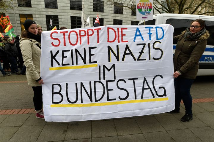 "Protesters hold a sign reading ""Stop the AfD. No Nazis in the German Parliament"" in Hanover, Germany, December 2, 2017."