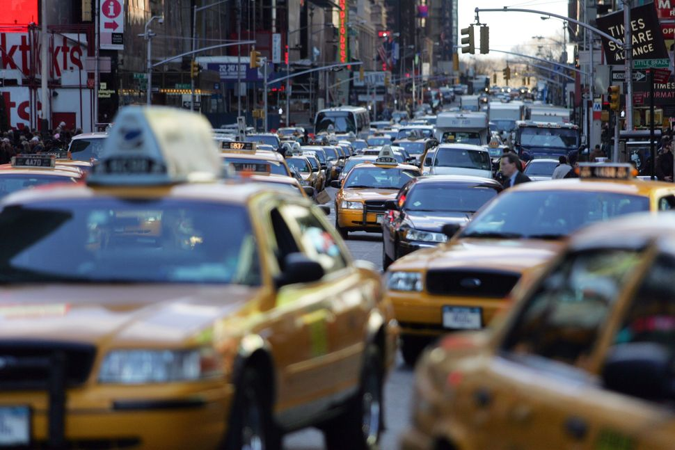 Traffic makes its way through Times Square in New York City.