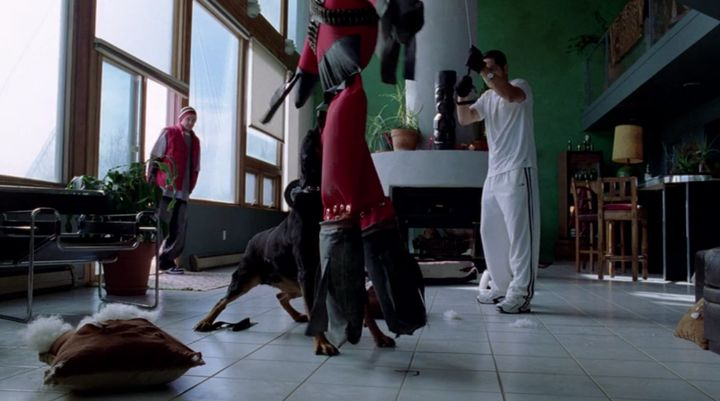 Jesse (Aaron Paul) pays Krazy-8 (Max Arciniega) and his attack dog a visit.