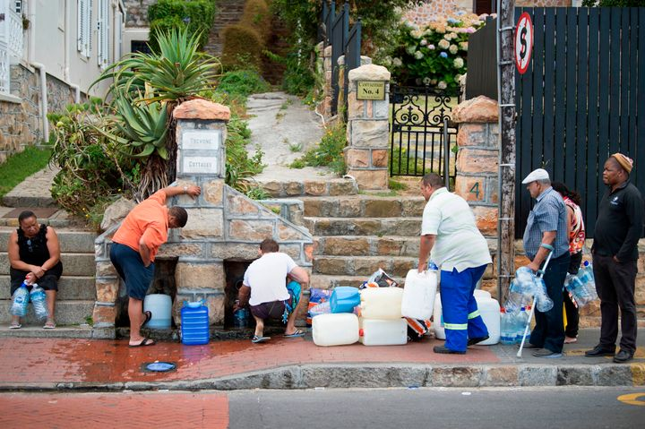 People collect water from pipes in Cape Town on Jan. 19.