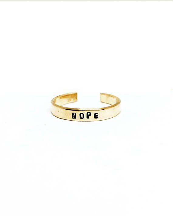 "Get it <a href=""https://www.etsy.com/listing/489824024/nope-handstamped-stackable-ring-mantra?ga_order=most_relevant&ga_s"