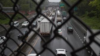 BRONX,  NY - MAY 25: Trucks and cars drive  on the Cross Bronx Expressway on May 25, 2017 in the Bronx, New York. The highway is one of the busiest in the nation, and the neighborhoods above it have very high levels of asthma in their communities. (Photo by Andrew Lichtenstein/Corbis via Getty Images)