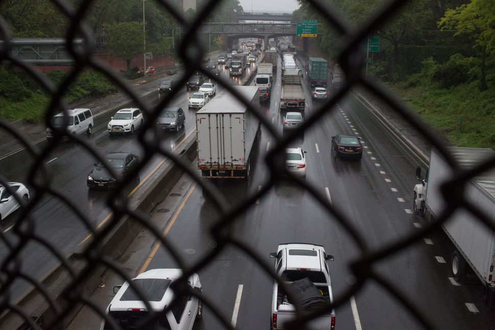 Trucks and cars drive on the Cross Bronx Expressway, one of the busiest highways in the U.S.