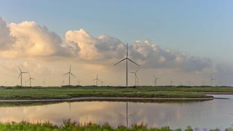 Wind turbines stand at the Avangrid Renewables' Baffin Wind Power Project in Sarita, Texas, U.S., on Wednesday, June 14, 2017. In the cut-throat Texas energy market, the construction of coastal wind turbinessome 900 in allhas had a profound impact. It's been terrific for consumers, helping further drive down electricity bills, but horrible for natural gas-fired generators. Photographer: Eddie Seal/Bloomberg via Getty Images