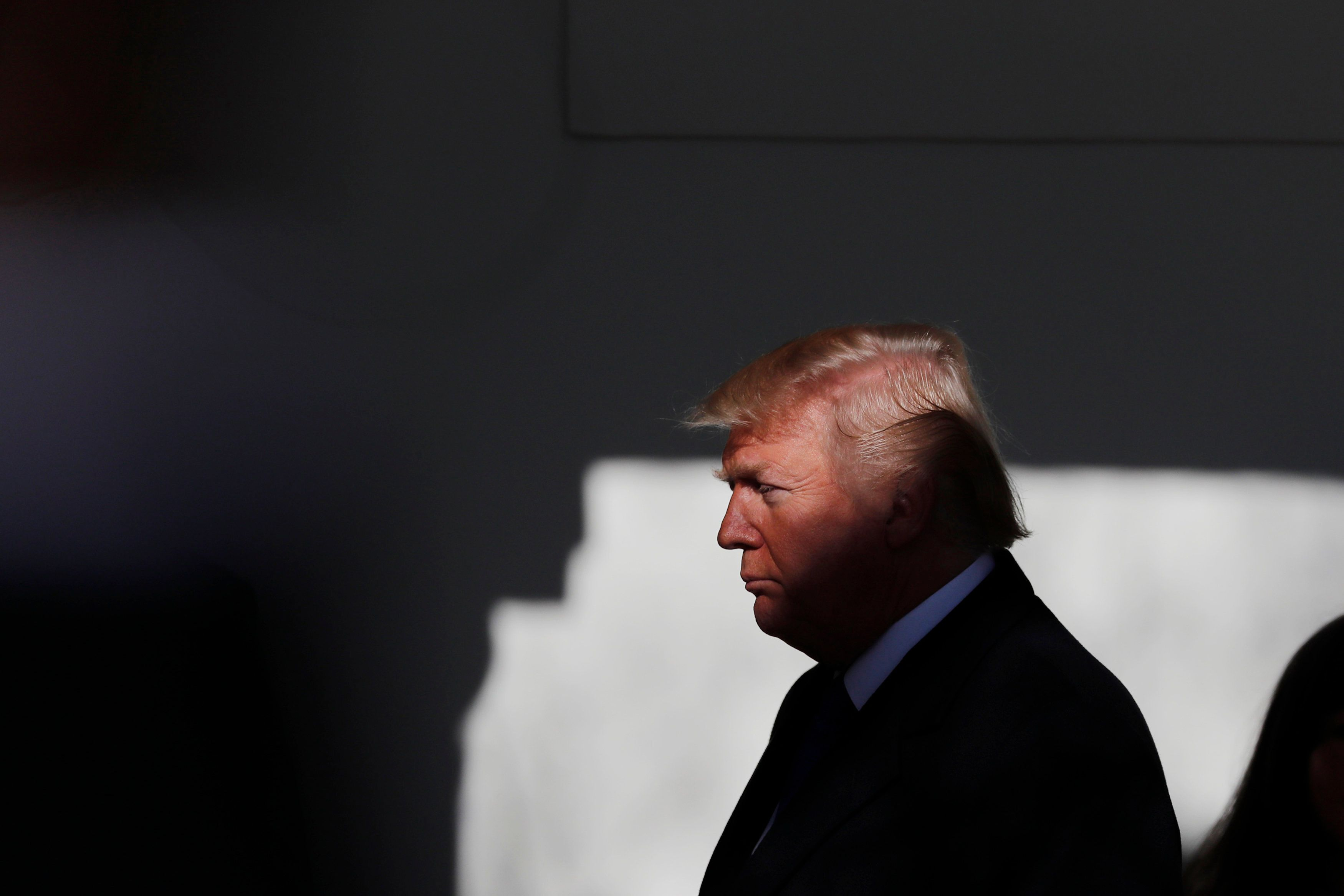 U.S. President Donald Trump prepares to address the annual March for Life rally, taking place on the nearby National Mall, from the White House Rose Garden in Washington, U.S., January 19, 2018. REUTERS/Carlos Barria