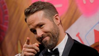 Actor Ryan Reynolds points into the crowd during ceremonies to honor him as Hasty Pudding Theatricals Man of the Year at Harvard University in Cambridge, Massachusetts, U.S. February 3, 2017.   REUTERS/Brian Snyder