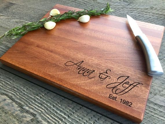 """Whether it's a set of monogrammed wine glasses or an <a href=""""https://www.etsy.com/listing/519201195/custom-cutting-board-per"""