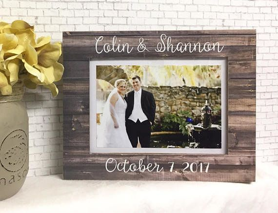 """Get creative with a <a href=""""https://www.etsy.com/listing/545378762/personalized-wedding-frame-personalized?ga_order=most_rel"""