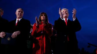 U.S. President Donald Trump and first lady Melania Trump participate in the National Christmas Tree Lighting and Pageant of Peace ceremony with Interior Secretary Ryan Zinke on the Ellipse near the White House in Washington, U.S., November 30, 2017. REUTERS/Jonathan Ernst