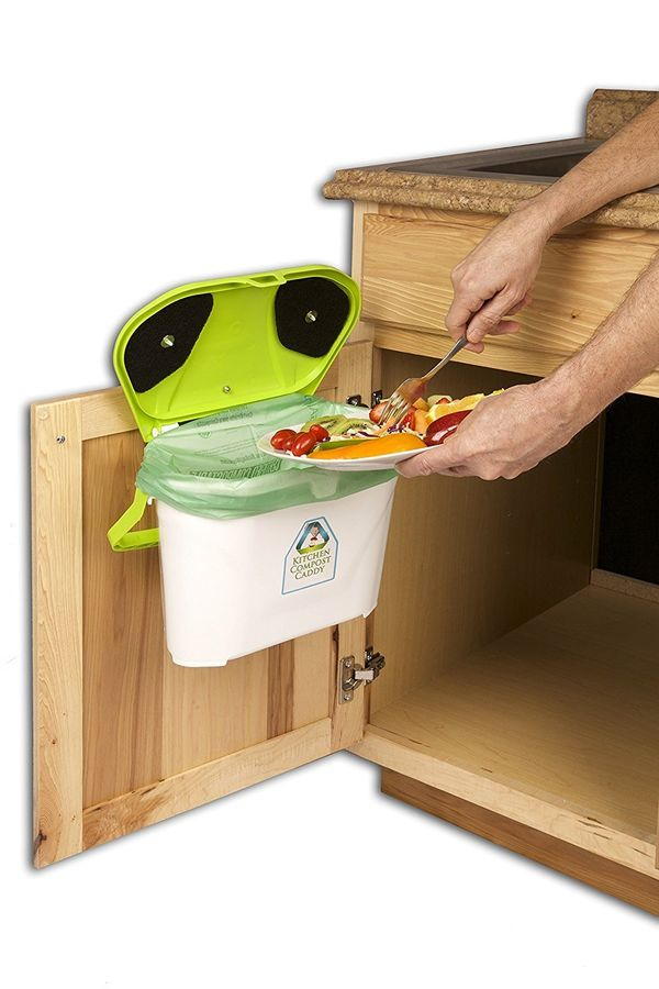 """Get it <a href=""""https://www.amazon.com/Kitchen-Compost-Caddy-Cabinet-Mounted/dp/B00BJW4FXG?tag=thehuffingtop-20"""" target=""""_bla"""