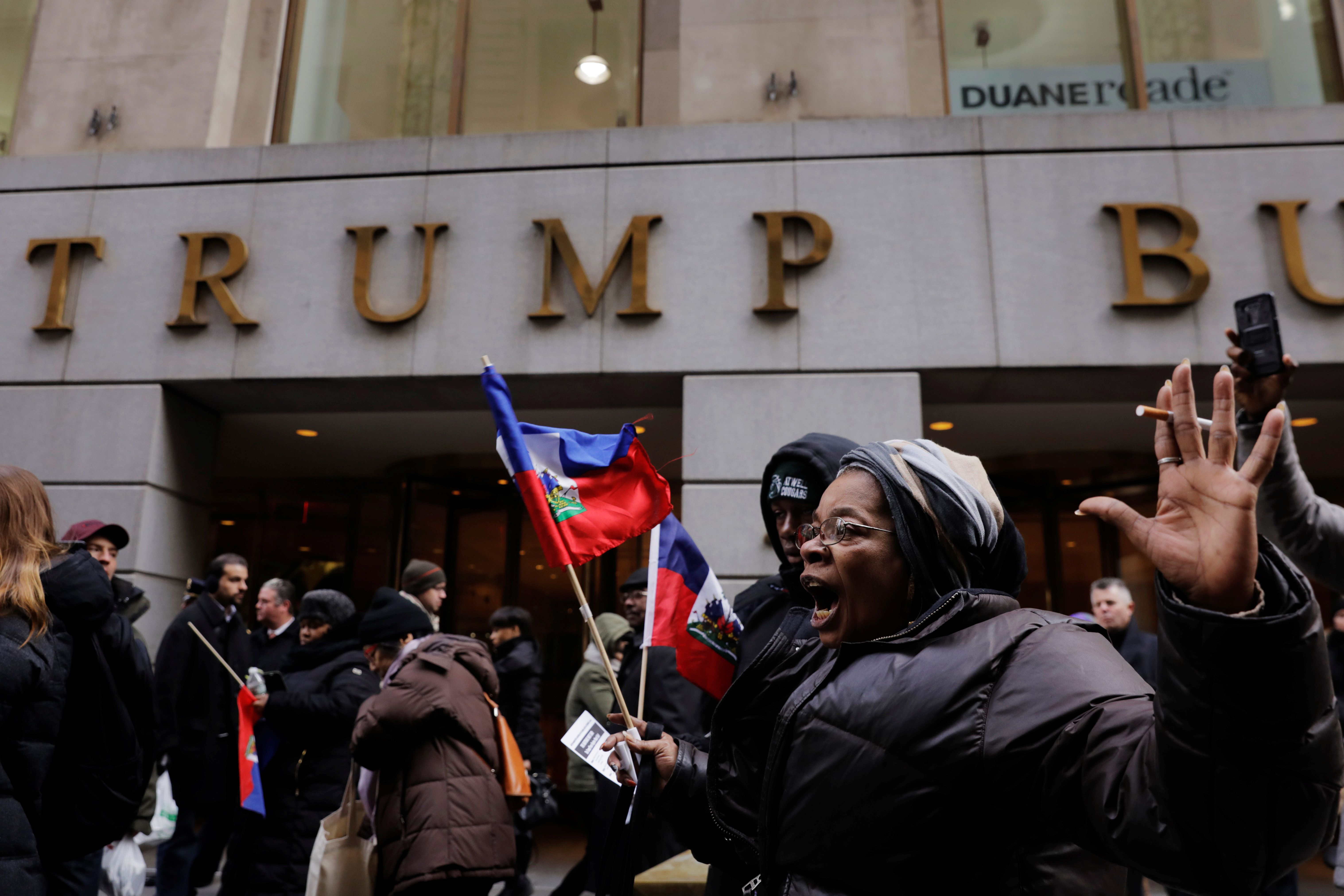 Haitian Americans demonstrated outside of Trump Tower after the president reportedly referred to several majority-black natio